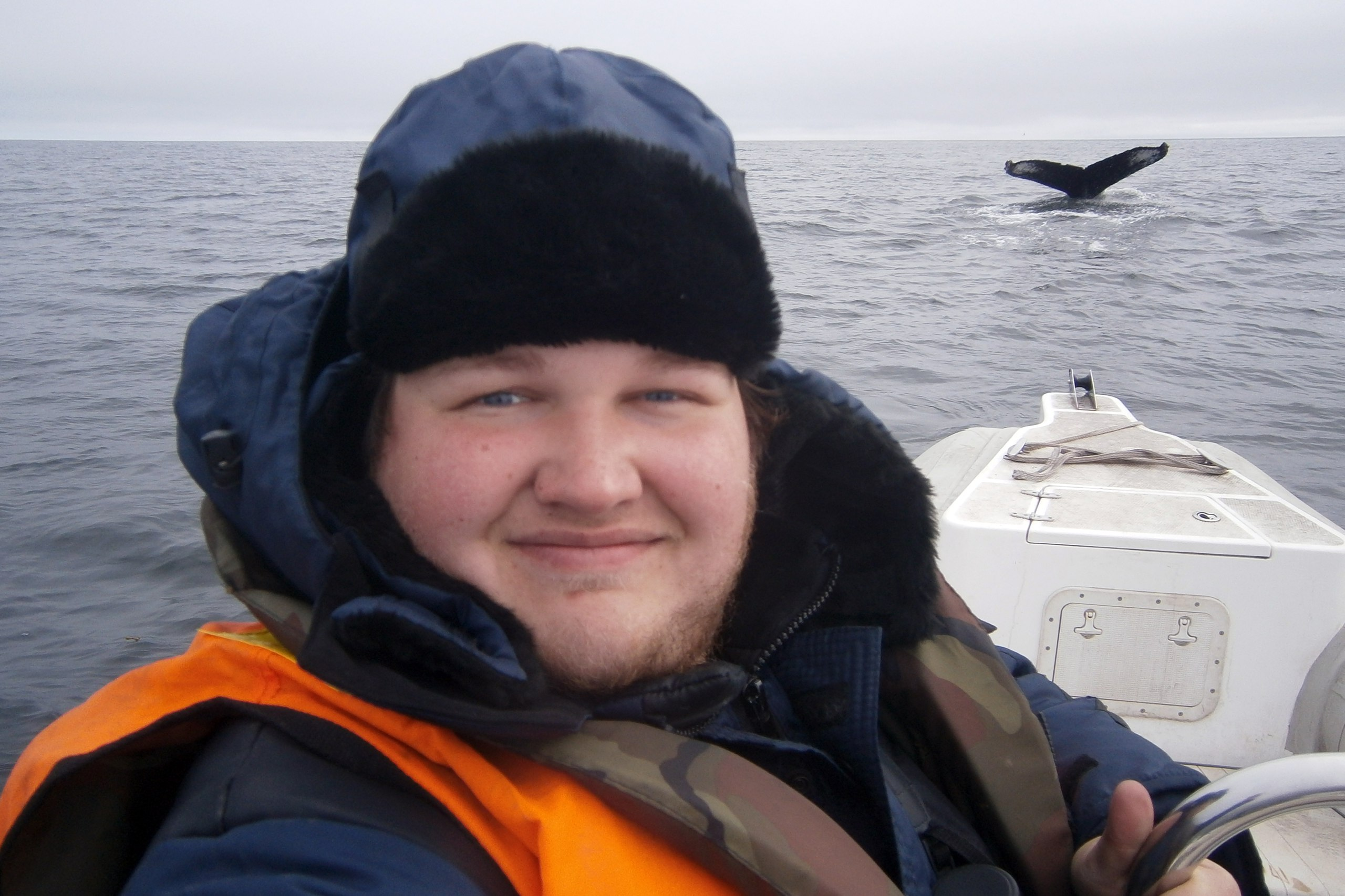 Alexander Sidorov during marine counts of cetaceans in the water area of the reserve. Photo by Alexander Sidorov