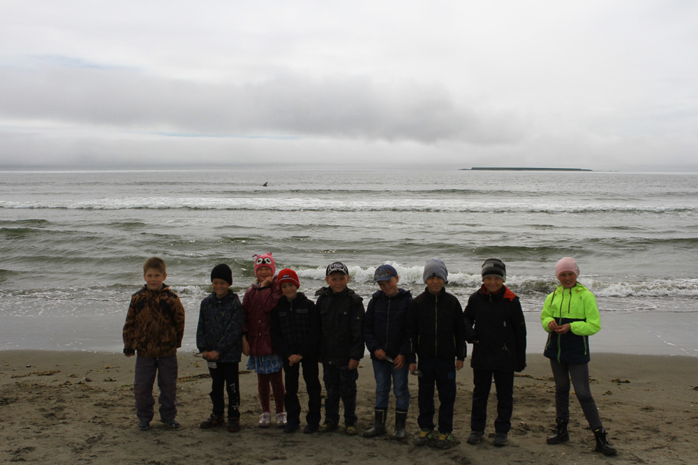 Children observed the grey whale. You can see its flipper above the water. Photo by the Commander Islands Reserve